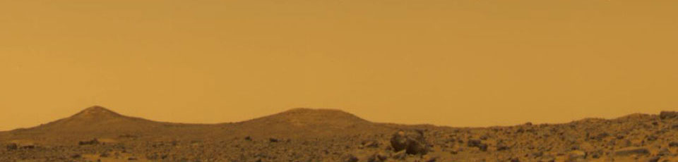 The orange-colored Martian sky during the daytime.